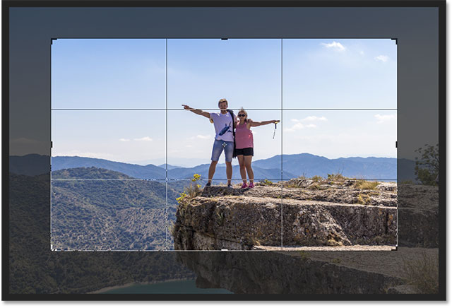 Photoshop completes the crop border when you release your mouse button.
