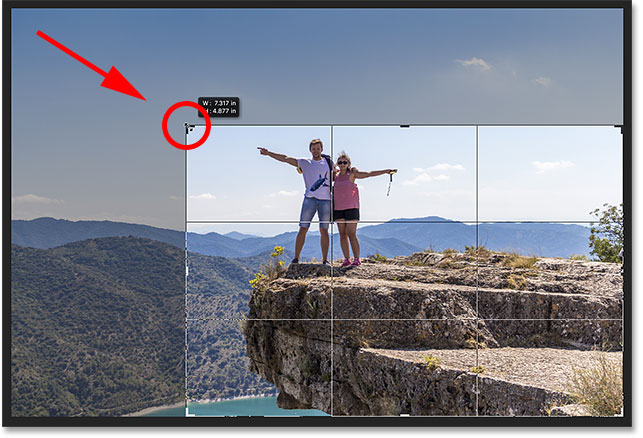 Hold Shift while dragging a corner handle to lock the aspect ratio.