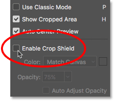 Unchecking the Enable Crop Shield option for the Crop Tool. Image © 2016 Photoshop Essentials.com