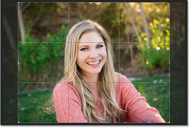 The crop border appears in landscape orientation this time. Image © 2016 Photoshop Essentials.com