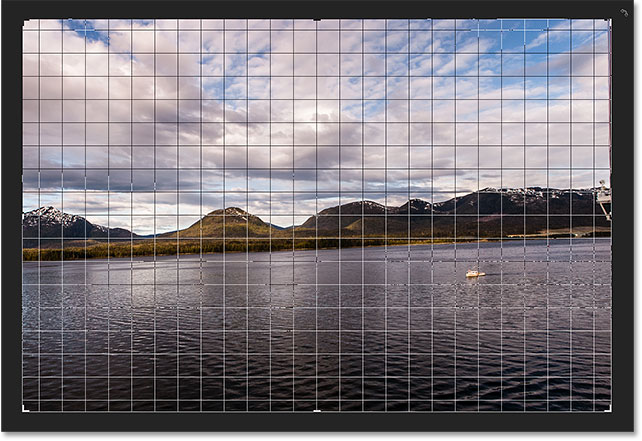 The 3 x 3 grid changes into a more detailed grid when you click and hold your mouse button. Image © 2016 Photoshop Essentials.com