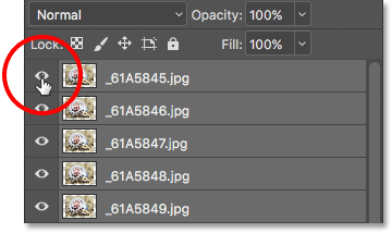 Holding Alt (Win) / Option (Mac) and clicking the top layer's visibility icon.