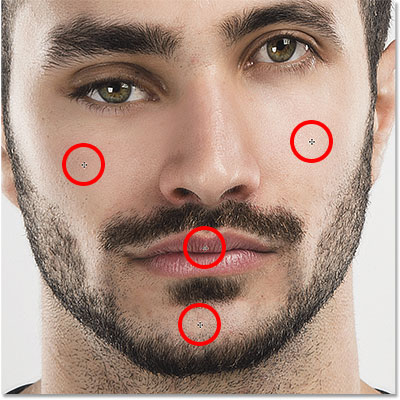 The cheeks, mouth and chin can all be reshaped with the Face Tool. Image © 2016 Steve Patterson, Photoshop Essentials.com