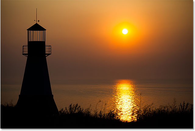 Lighthouse at sunset. Image #69545379 licensed and used by permission from Fotolia by Photoshop Essentials.com
