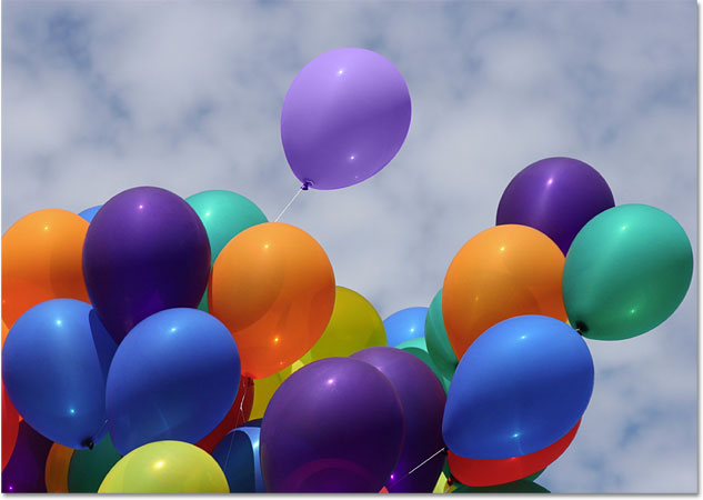 The orange balloon is now a light purple balloon. Image © 2010 Photoshop Essentials.com
