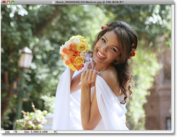A photo of a bride smiling. Photo licensed from iStockphoto by Photoshop Essentials.com