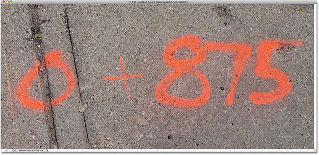 A photo of numbers spray painted on a sidewalk. Image © 2010 Steve Patterson, Photoshop Essentials.com