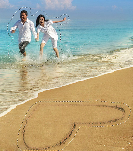 Adding the couple and the heart shape on the beach to the selection. Image © 2012 Photoshop Essentials.com