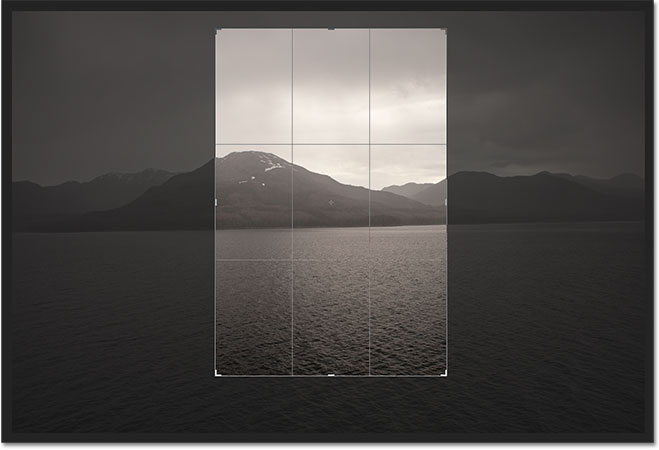 The crop border has been rotated from landscape to portrait orientation. Image © 2012 Photoshop Essentials.com