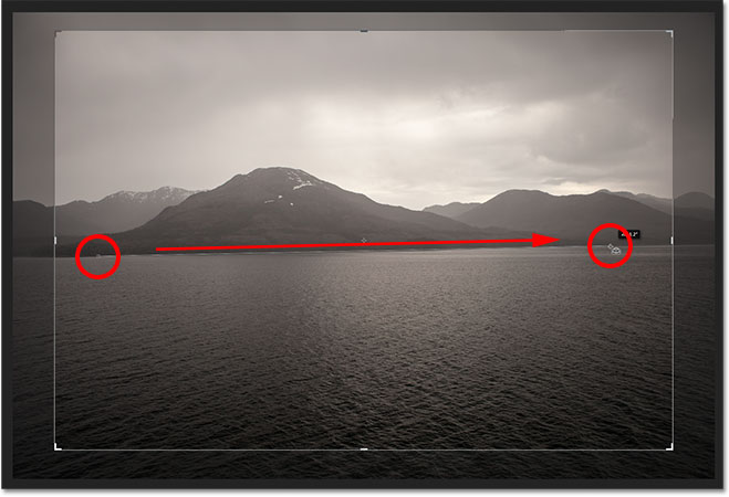 Click and drag along something that should be straight in the photo. Image © 2012 Photoshop Essentials.com