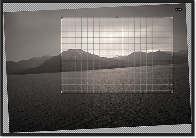 Click and drag anywhere outside the crop box to rotate the image. Image &copy; 2012 Photoshop Essentials.com