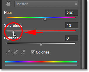 Lowering the intensity of the eye color with the Saturation slider.
