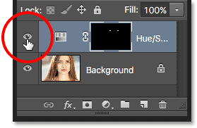 Clicking the visibility icon for the Hue/Saturation adjustment layer.
