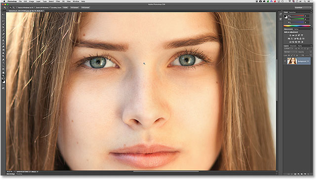 Zooming in on the woman's eyes with the Zoom Tool.