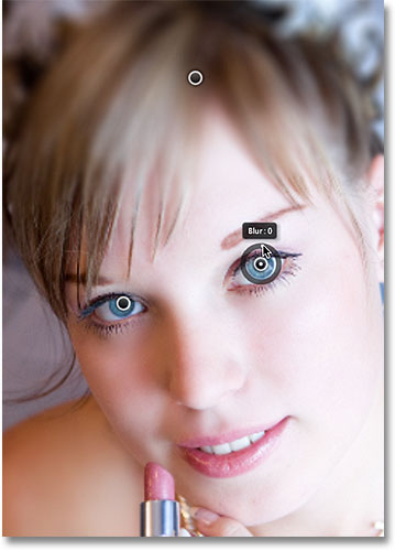 Bringing back the sharpness in the eyes with two additional pins. Image © 2012 Photoshop Essentials.com