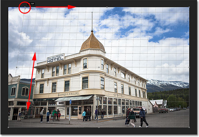 Dragging the top left crop handle to adjust the perspective grid. Image © 2012 Steve Patterson