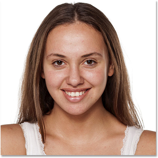 Smiling young woman without make-up, looking at the camera. Image #89969729 licensed from Adobe Stock by Photoshop Essentials.com