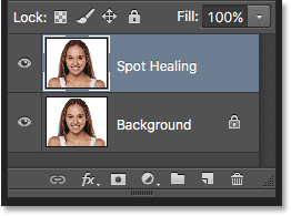 The Layers panel showing the Spot Healing layer. Image © 2016 Steve Patterson, Photoshop Essentials.com