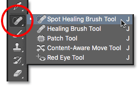 Selecting the Spot Healing Brush from the Tools panel in Photoshop. Image © 2016 Photoshop Essentials.com