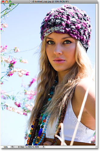 A colorful photo of a blond woman wearing a knitted cap. Image licensed from iStockphoto by Photoshop Essentials.com