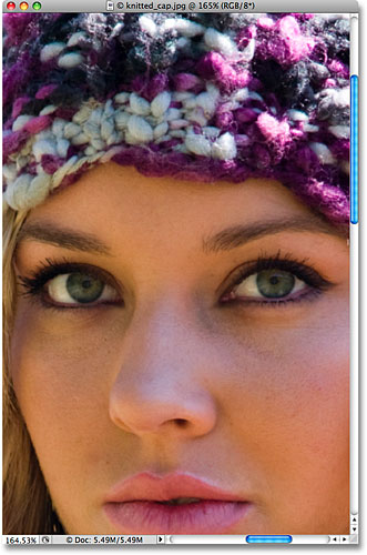 Zooming in on the woman's eyes in Photoshop. Image  2009 Photoshop Essentials.com