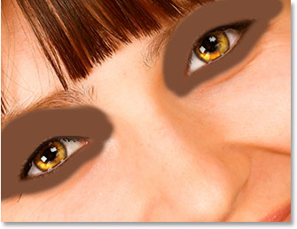 Paint with your sampled color around and above the eyes