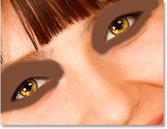 Pinte com a sua cor da amostra em torno e acima dos olhos