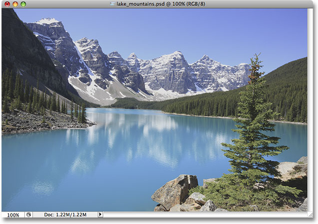 A photo of a lake and mountains. Image licensed from iStockphoto by Photoshop Essentials.com.