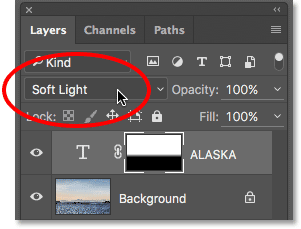 Changing the Type layer's blend mode to Soft Light. Image © 2016 Photoshop Essentials.com