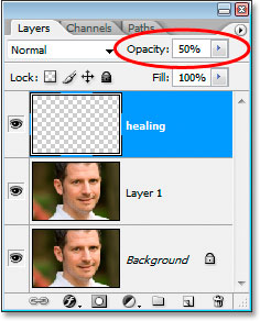 Lowering the opacity of the healing layer in the Layers palette