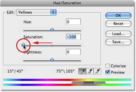 Dragging the Saturation slider to the left to remove the yellow from the teeth. Image © 2008 Photoshop Essentials.com.