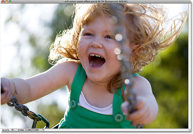 A photo of a young girl on a swing. Image licensed from iStockphoto by Photoshop Essentials.com.