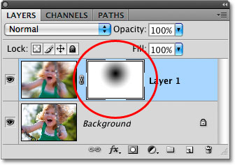The radial gradient is visible in the layer mask thumbnail in the Layers panel. Image © 2008 Photoshop Essentials.com.