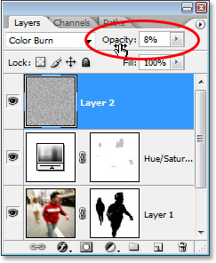 Lowering the opacity of the noise layer to 8%.