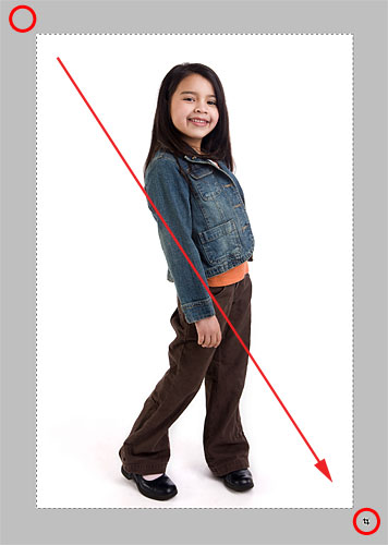 Dragging the Crop Tool across the image. Image © 2010 Photoshop Essentials.com.