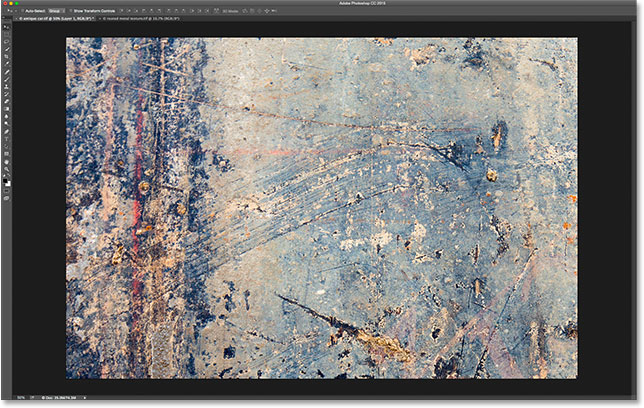 Selecting the Paste command from the Edit menu in Photoshop. Image © 2015 Photoshop Essentials.com.