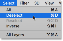 Choosing Deselect from under the Select menu in Photoshop.