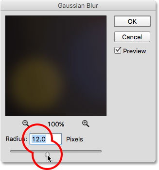 Dragging the Radius slider in the Gaussian Blur dialog box.