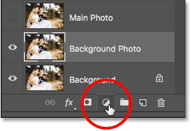 Clicking the New Fill or Adjustment Layer icon at the bottom of the Layers panel in Photoshop. Image © 2017 Photoshop Essentials.com.