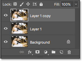 The Layers panel now showing the original Background layer and two copies above it. Image © 2017 Photoshop Essentials.com.