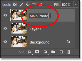 Renaming the top layer 'Main Photo'. Image © 2017 Photoshop Essentials.com.