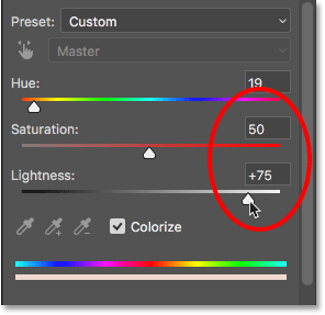 Increasing the Saturation and Lightness values in the Properties panel. Image © 2017 Photoshop Essentials.com.