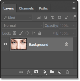 The Layers panel showing the photo on the Background layer. Image © 2016 Photoshop Essentials.com.