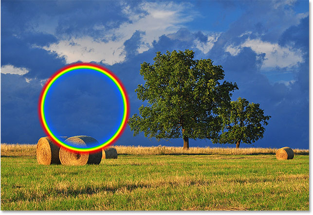 The first rainbow gradient is too small and in the wrong location. Image © 2016 Photoshop Essentials.com.