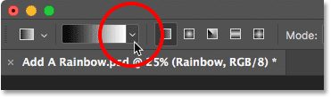 Clicking the arrow to the right of the gradient preview thumbnail. Image © 2016 Photoshop Essentials.com.