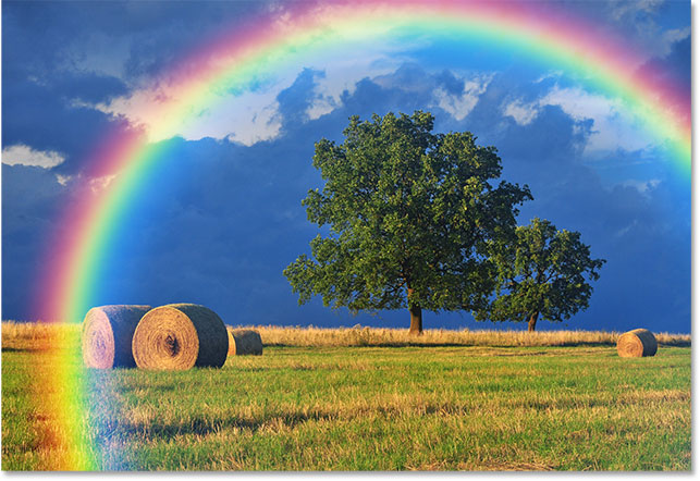 The result after applying the Gaussian Blur filter to the rainbow gradient. Image © 2016 Photoshop Essentials.com.