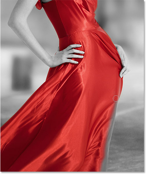 Continuing around the edges of the dress to reveal the color. Image © 2015 Photoshop Essentials.com.
