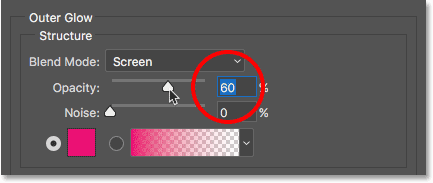 Lowering the opacity of the Outer Glow layer style.
