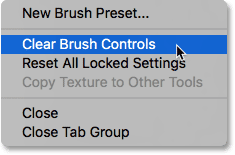 Choosing Clear Brush Controls from the Brush panel menu. Image © 2017 PhotoshopEssentials.com.