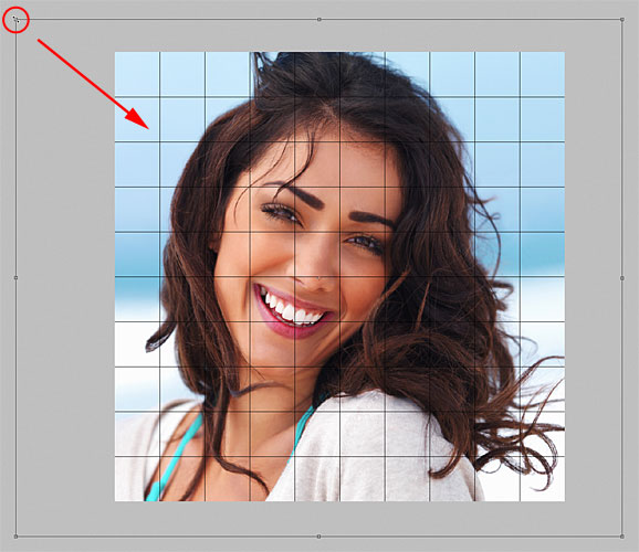 Resizing the photo with Free Transform in Photoshop. Image © 2011 Photoshop Essentials.com.